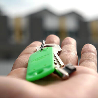 New home keys in the palm of a hand