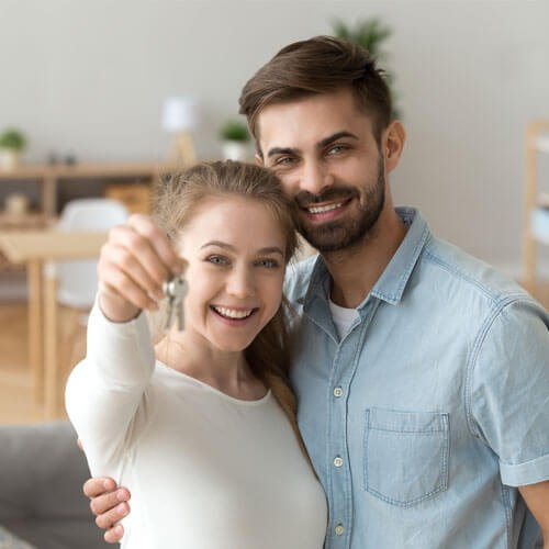 Couple holding new home keys